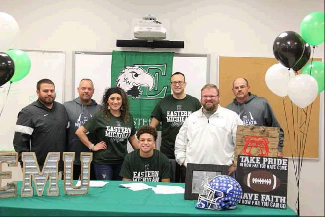 Rodney Haltom I The Democrat Checotah's Jacob Barrett signed his letter of intent to play football for the University of Eastern Michigan. Pictured left to right are Checotah football coaches Jimmy Whitlock, Tom Butler, Jacob's parents Crystal and Joh
