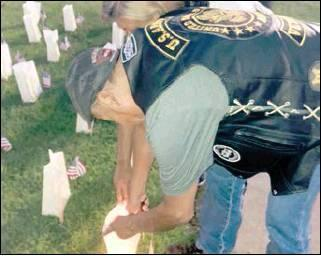 LaDonna Rhodes I The Democrat Michael D. Coon lights his son's luminary during the Gold Star Luminary Initiative on Sept. 29. See next week's edition for more photos of the luminary.