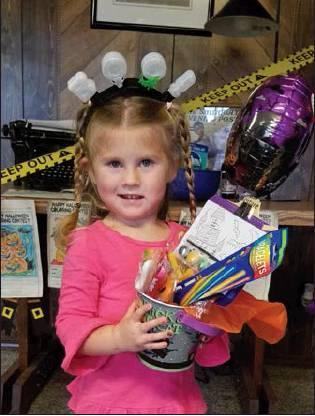 Staff photo RayLynn Tarkington won the McIntosh County Democrat's Halloween coloring contest sponsored by Pizza Hut, McDonald's and Subway. Thanks to everyone who participated.
