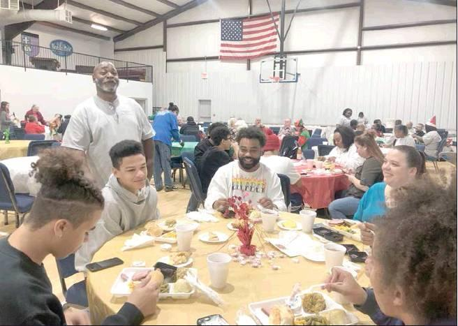 LaDonna Rhodes I The Democrat Sam Cunningham visited with members of the community at the Feeding All Souls Christmas luncheon. SEE MORE PHOTOS ON PAGE A10.