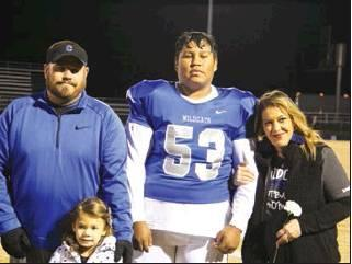 RODNEY HALTOM   THE DEMOCRAT Chance Wood escorted by his parents Jimmy and Sommer Whitlock on Senior Night.
