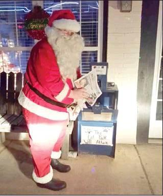 Courtesy Photo Look who Wilma Hays caught picking up his favorite newspaper. Yes, Santa loves the McIntosh County Democrat.