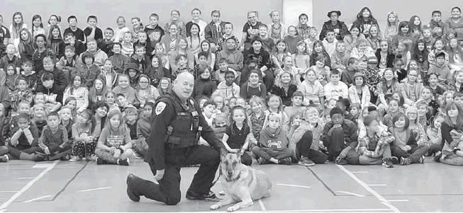 Submitted photo Deputy Bryan Jones and his partner Tibo spoke with over 300 Checotah Intermediate students on Oct. 29 about staying drug free. His presentation was part of Red Ribbon Week where the kids are taught the dangers of drugs and alcohol use.