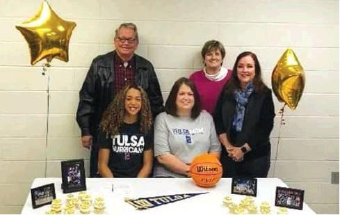 Checotah basketball standout Olivia Clayton (seated, left) signed a national letter of intent Wednesday with the University of Tulsa. Seated COURTESY next to her is her mother, Brandy Clayton. Standing (from left) are grandparents Bobby and Kathy Reynolds