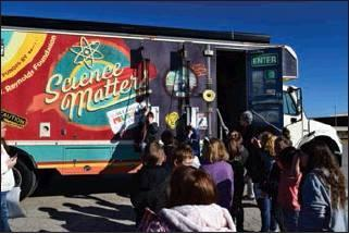 LADONNA RHODES | THE DEMOCRAT Students from Ms. Lacie William's 4th grade class try their hand at the pulley systems on the Science Matters Mobile Museum truck